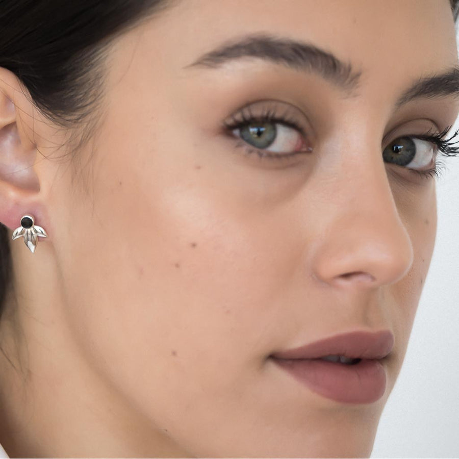 Model wearing Bloom earrings silver black spinel