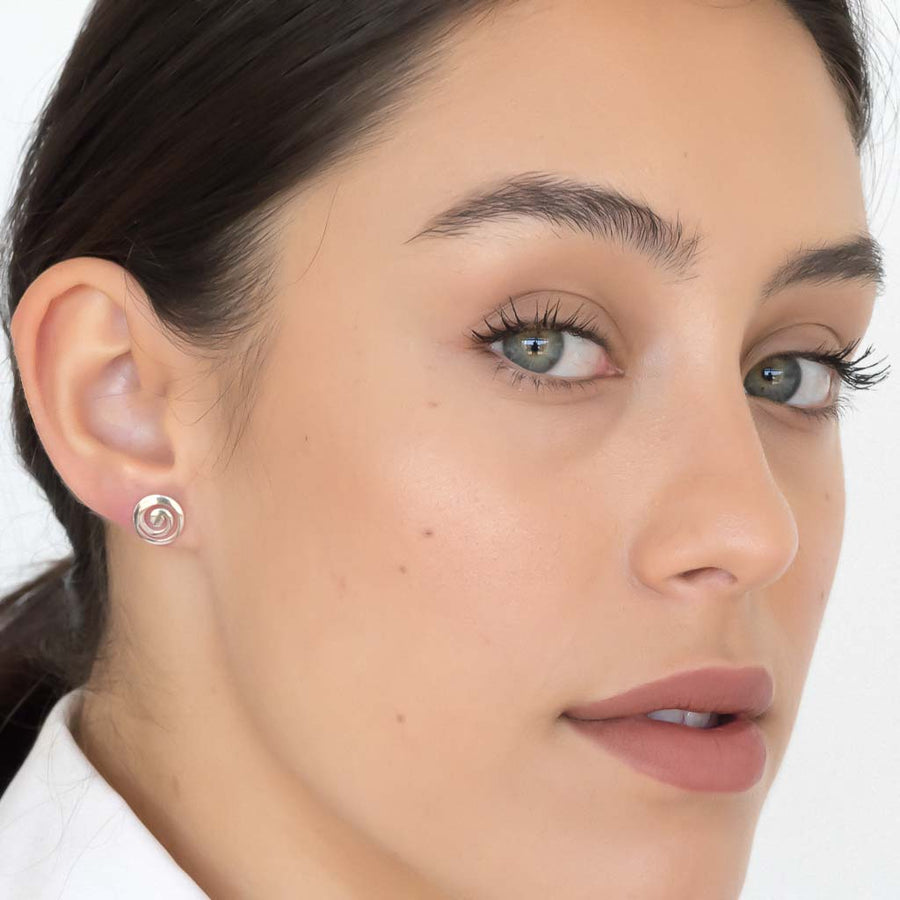 Model wearing Current earrings sterling silver