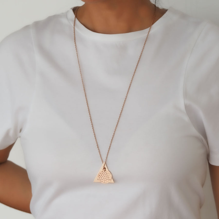 Model wearing Dandelion and Deltaglyph Rose Gold on long chain