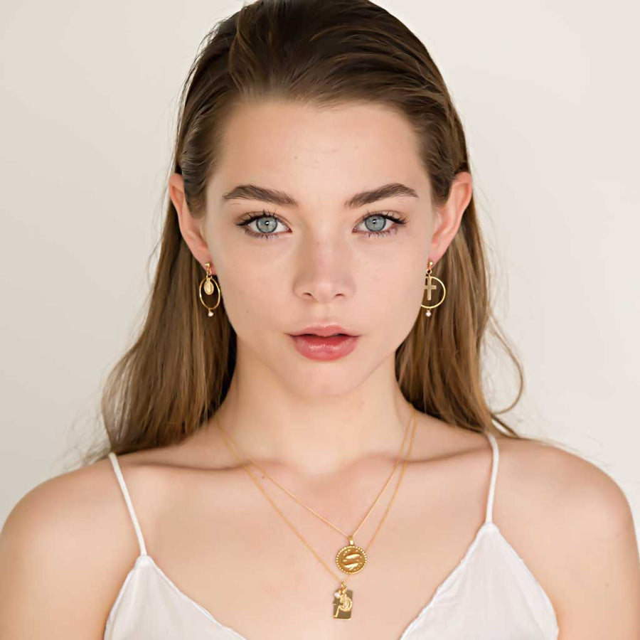 Model wearing Reflections Faith Pearl Necklace - Gold