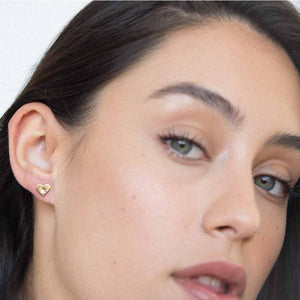 Model wearing Heartbeat stud earrings gold