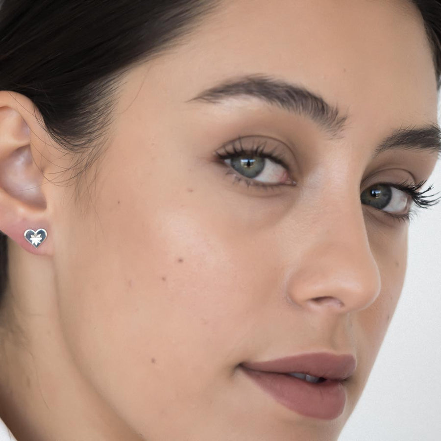 model wearing Dandelion stud earrings sterling silver