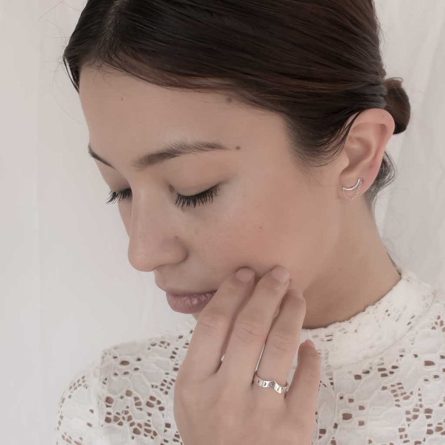 Model wearing I wish ring and crescent moon earrings