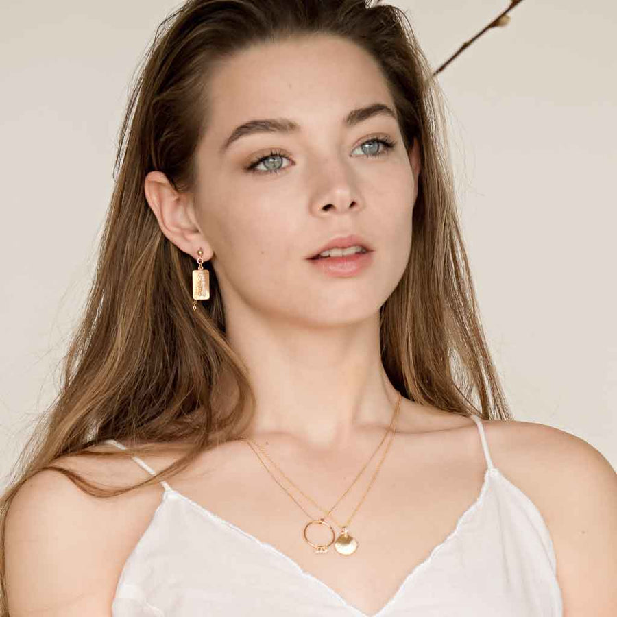 Model wearinh Impressions Shell Necklace Gold styled
