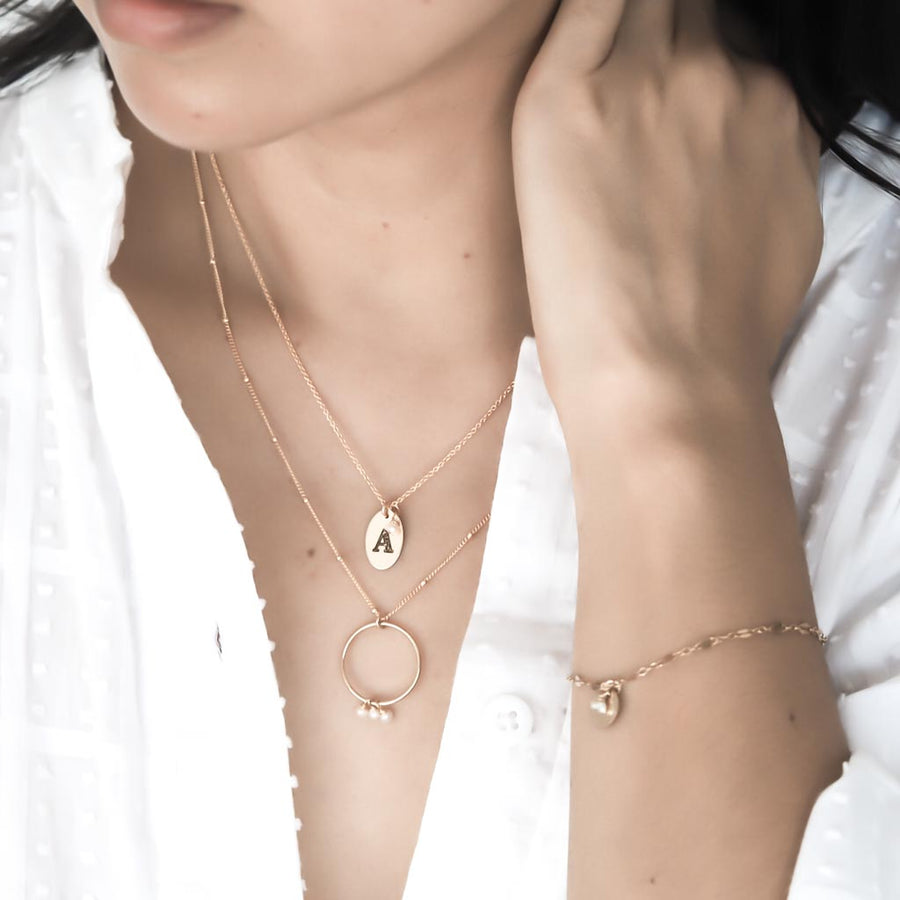Model wearing Love letter, Halo Constellation and Unity bracelet gold