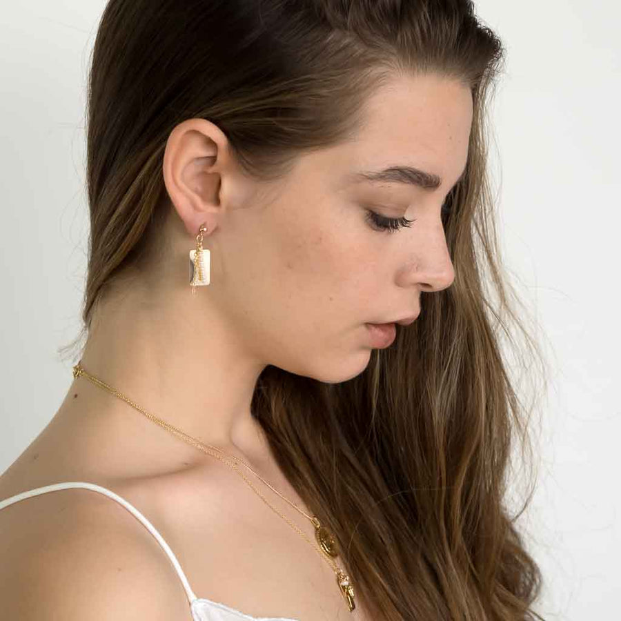 Model wearing Reflections Pearl Drop Earrings