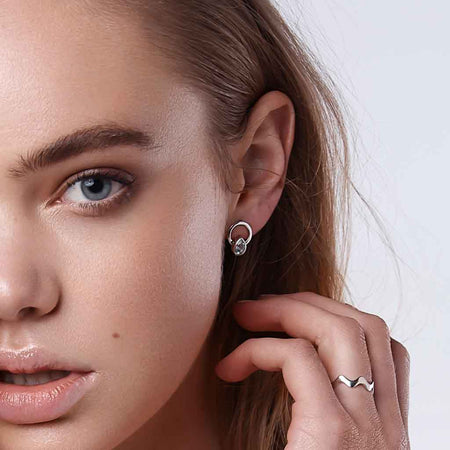 Model wearing Teardrop single ray earrings silver aquamarine 2