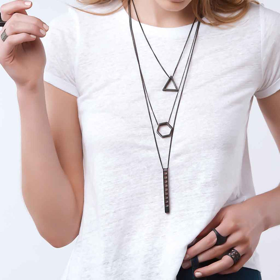Model wearing sixdblack pendants