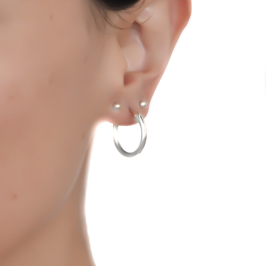 Model wearing Perfect Hoop Earrings 19mm