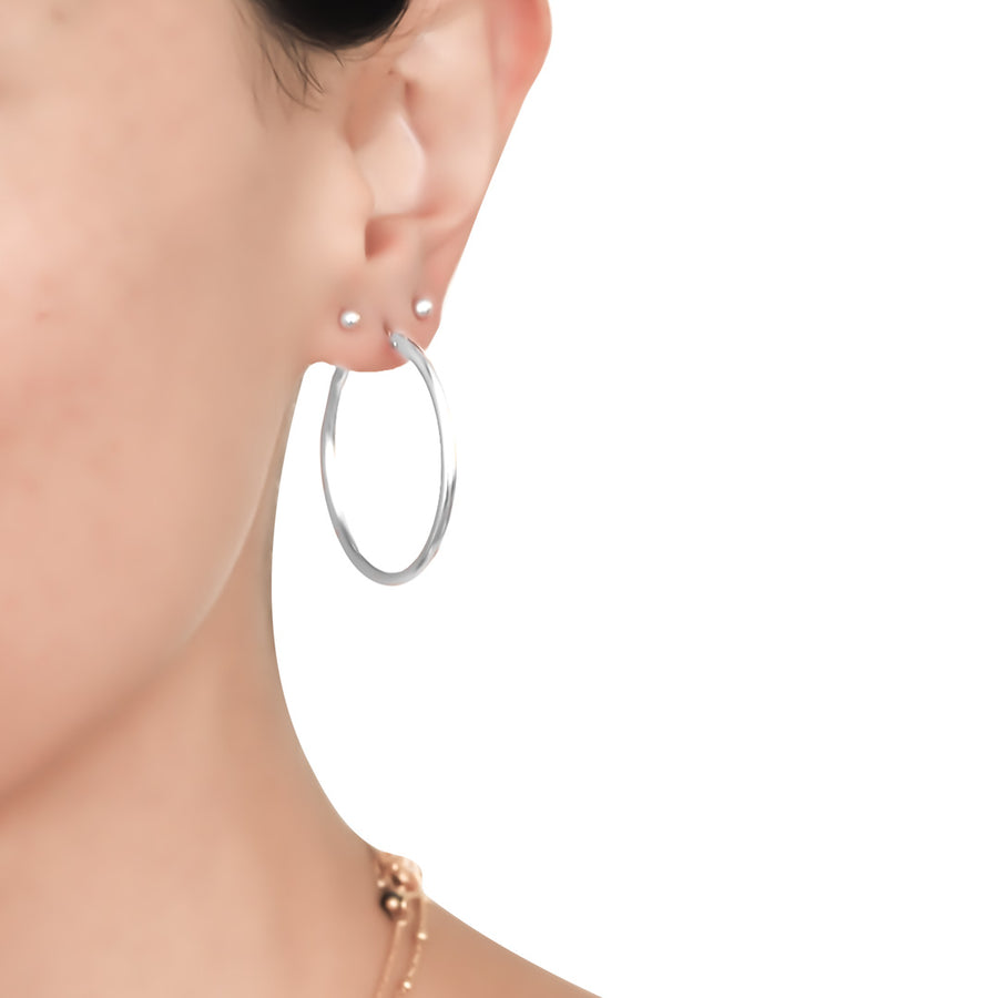 model wearing Perfect Hoop Earrings 34mm