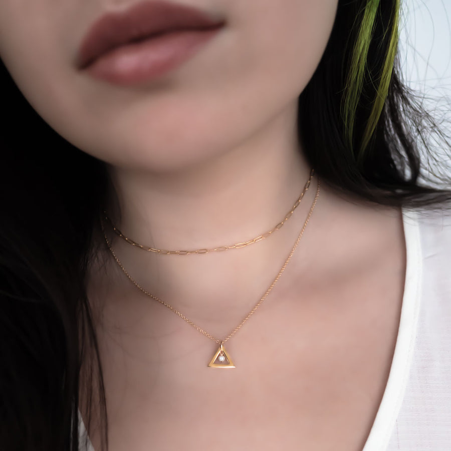 Model wearing triangle chime necklace