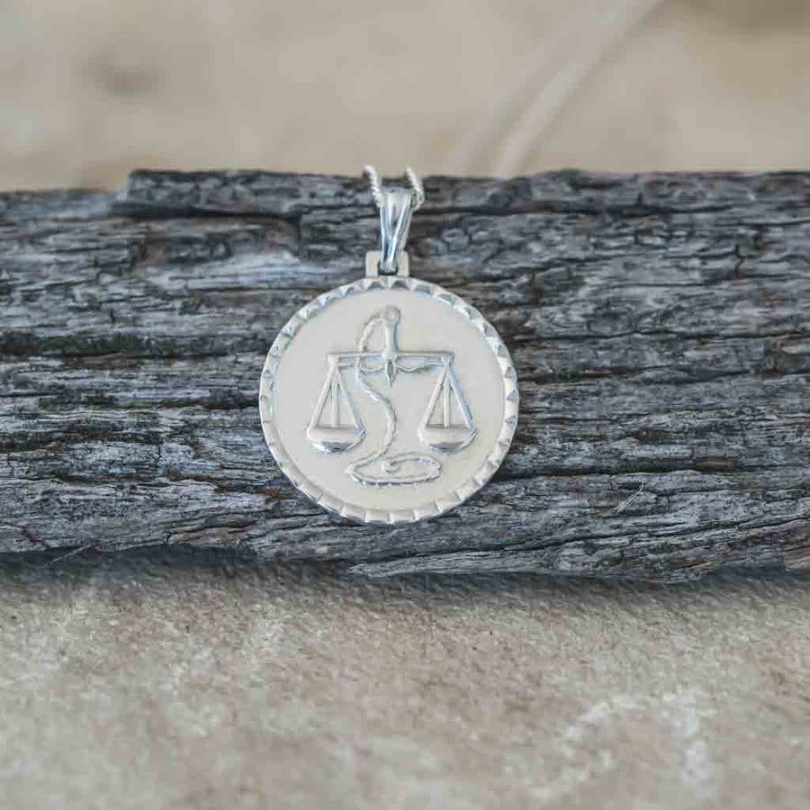 The Libra Necklace on wood