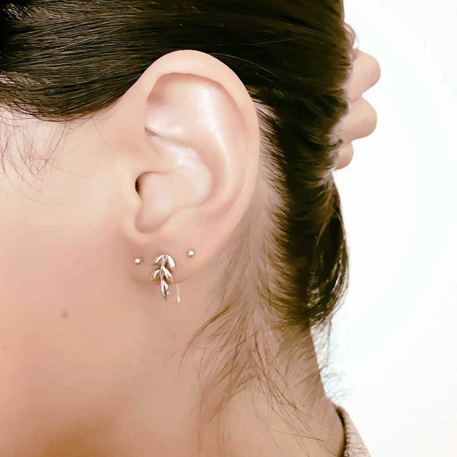 Model wearing Little leaf Earrings styled