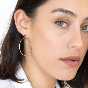 products/model_wearing_Circlette_Hoop_earrings_rose_gold_black_spinel.jpg