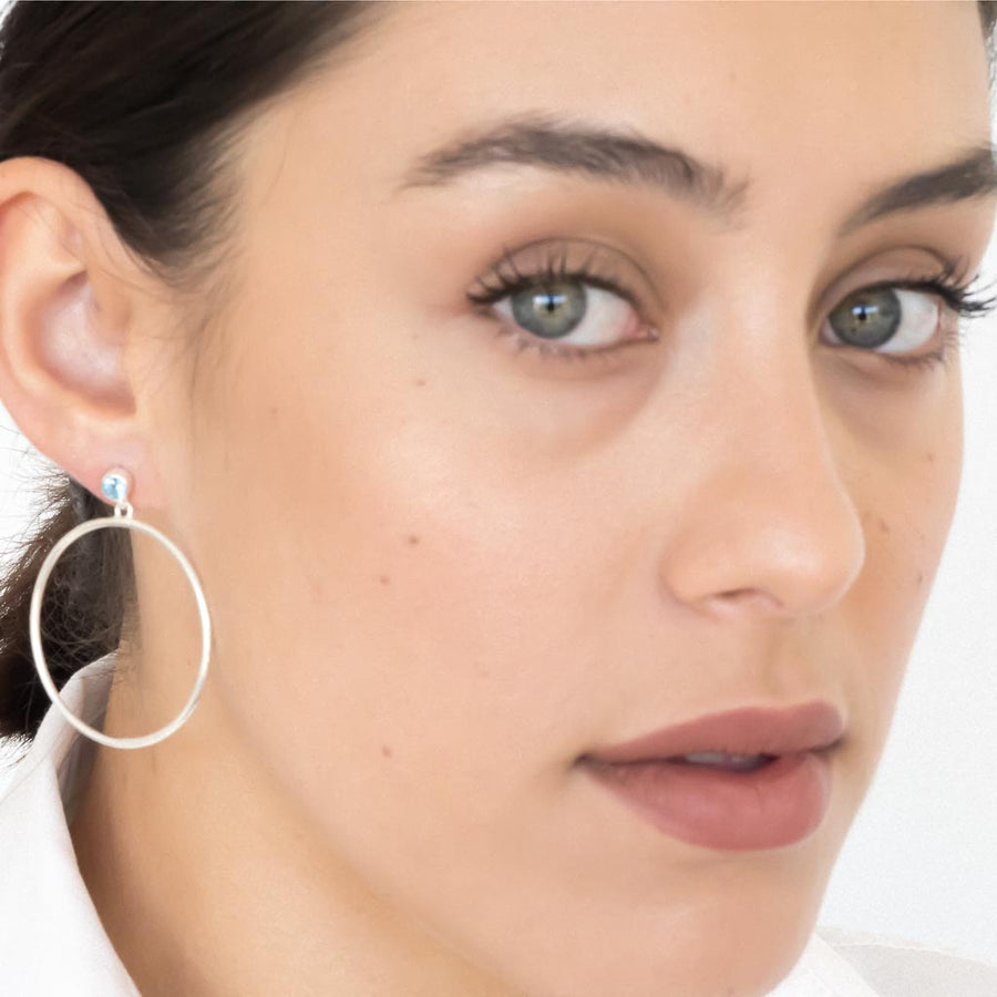 model wearing Circlette Hoop earrings silver swiss blue topaz