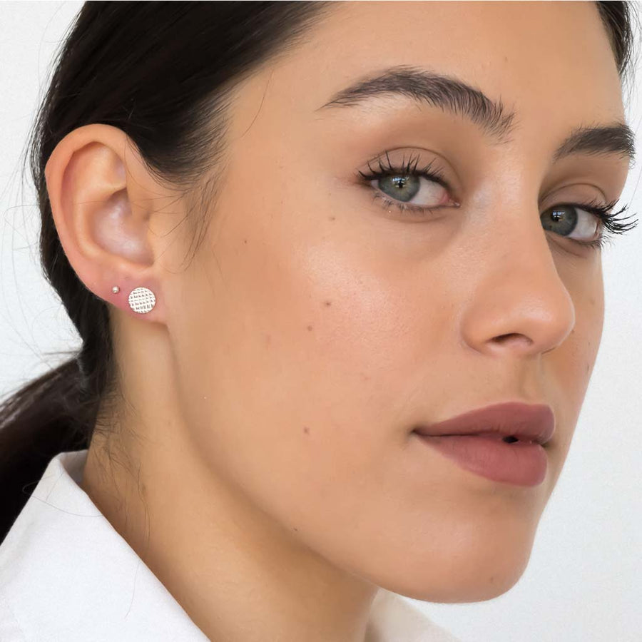 model wearing Rain stud earrings sterling silver