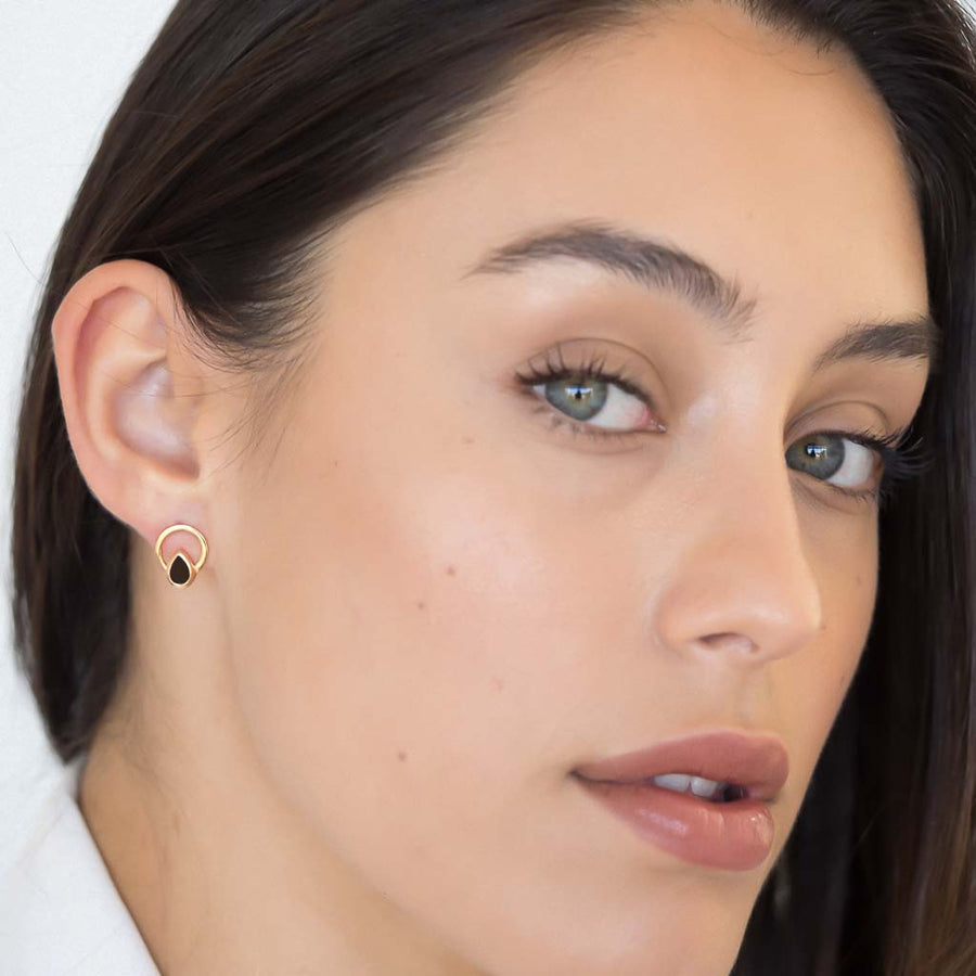 model wearing Teardrop single ray earrings rose gold smoky quartz