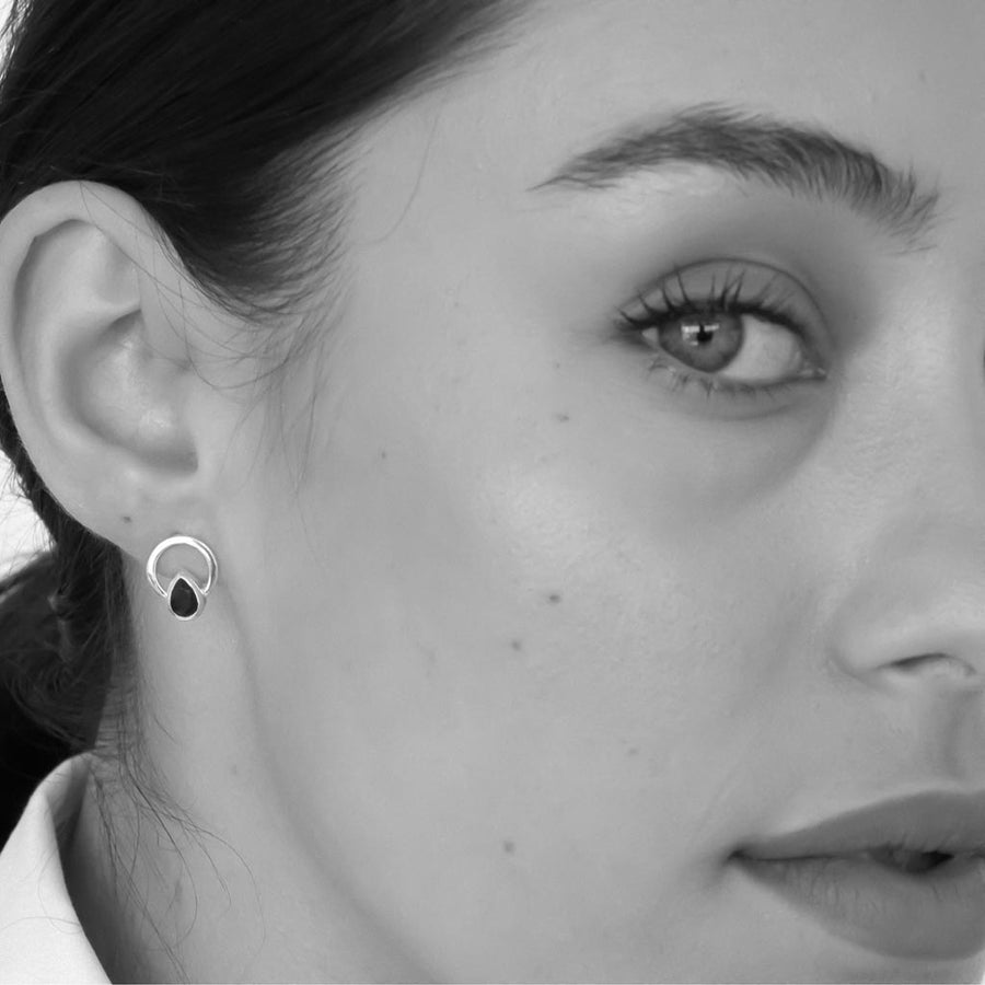 model wearing Teardrop single ray earrings sterling silver black spinel
