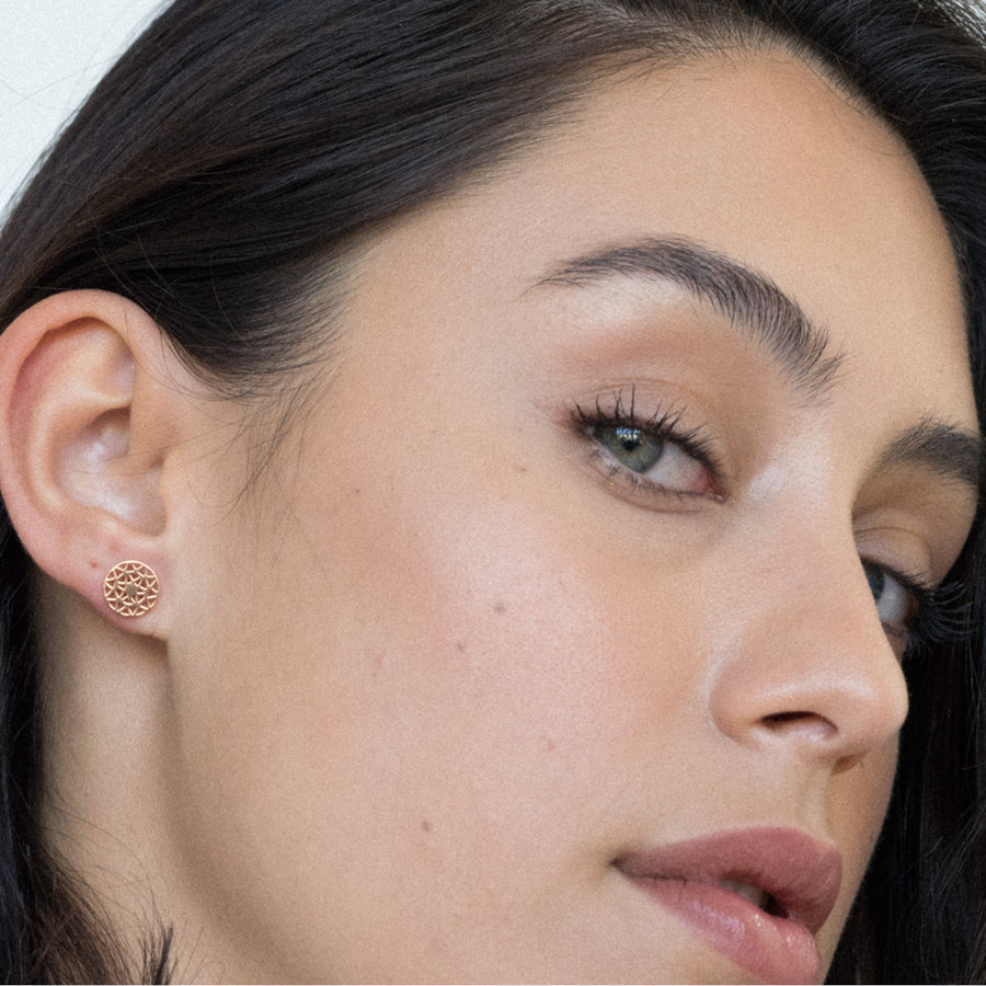 model wearing dandelion stud earring rose gold