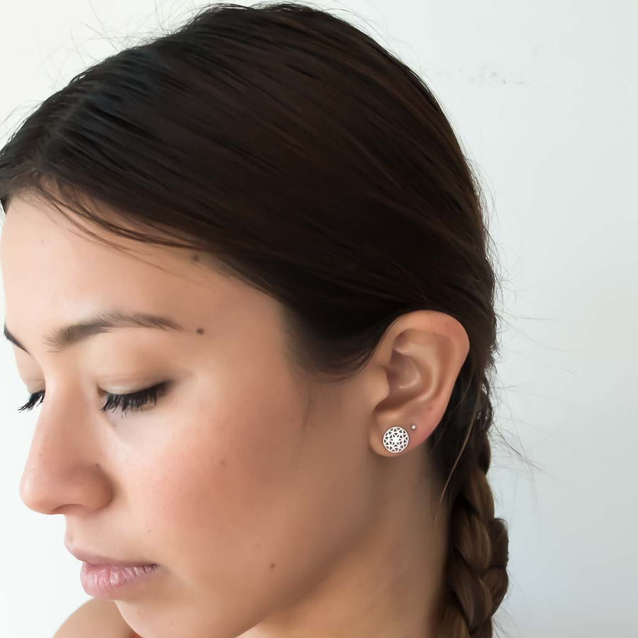 model wearing dandelion stud earrings silver1