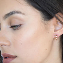 model wearing little leaf earrings rose gold down