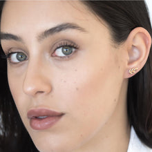model wearing little leaf earrings rose gold up