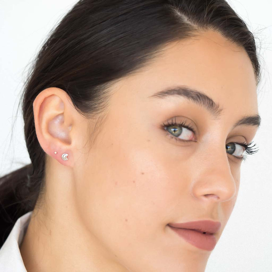 model wearing moon in moon earrings sterling silver
