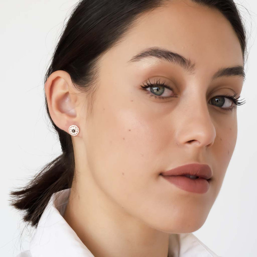 model wearing taraxacum earrings silver black spinel