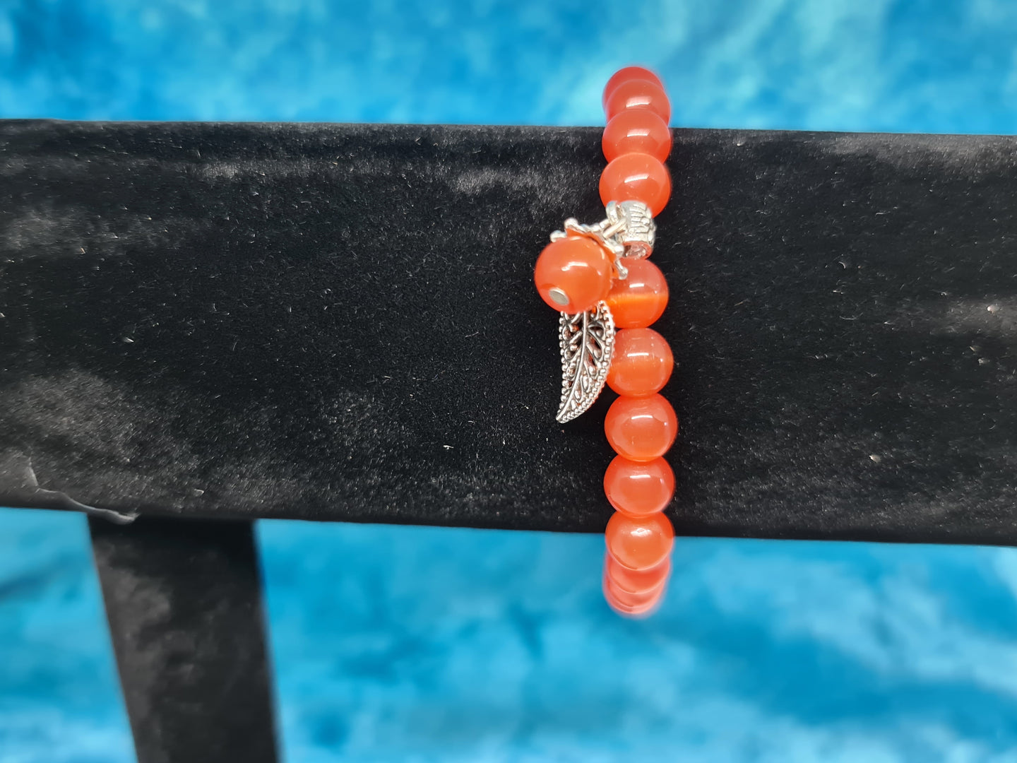 Cat eye armband rood/oranje