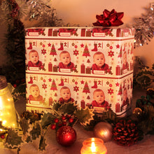 Custom gift wrapped package with Christmas ornaments and baby