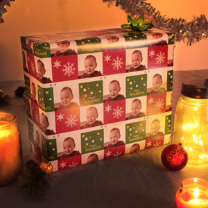 Red and green squares, snowflakes Christmas gift wrapped package