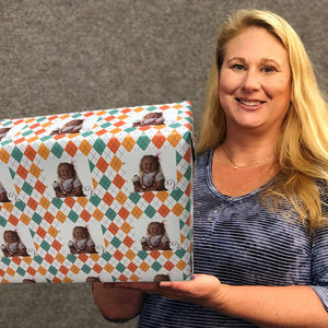 Carrie Weimer  with roll of designer gift wrapping paper