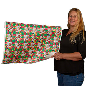 Roll of custom printed gift wrapping paper held by Carrie Weimer