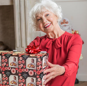 Grandma receiving custom photo gift wrapped package with delight