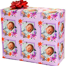 Gift wrapped package with purple butterflies and flowers photo of baby repeating pattern