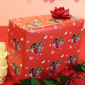 Gift wrapped package with hearts and family photograph