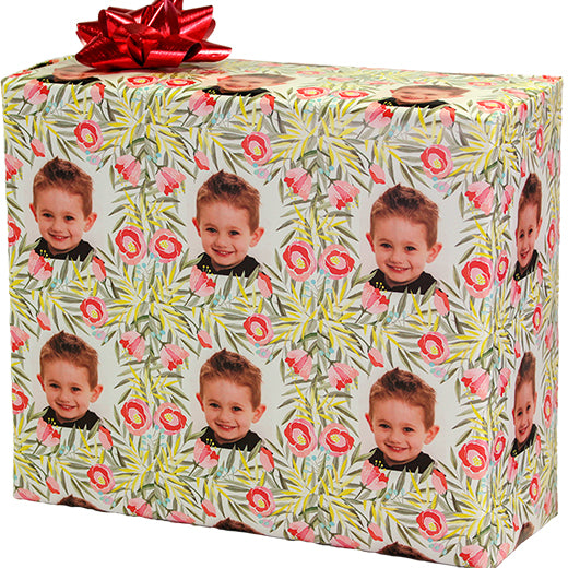 Wrapped gift box with red bow custom photo of boy on water color flowers repeating pattern