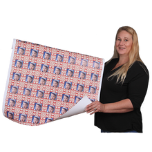 Carrie Weimer  with roll of personalized gift wrapping paper