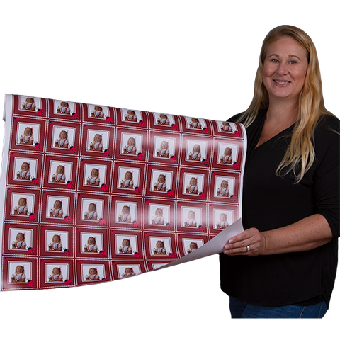 Carrie Weimer  with roll of personalized gift wrapping paper with red ladybugs