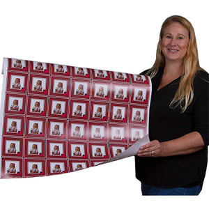 Roll of designer red ladybug gift wrapping paper held by Carrie Weimer