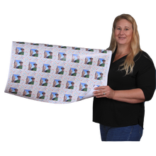 Roll of custom printed gift wrap held by woman