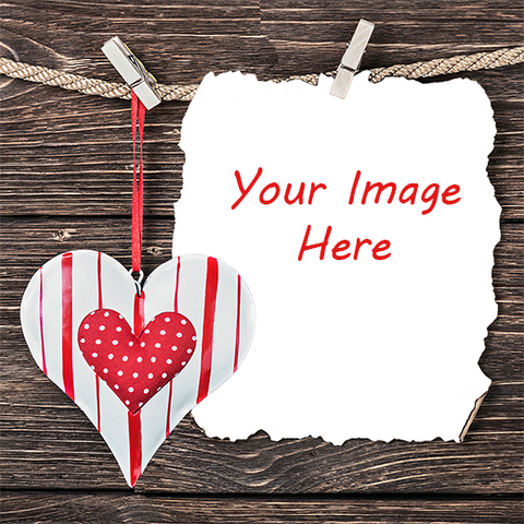 Heart and photograph on parchment against wood background