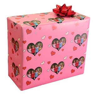 Valentine gift wrapping paper on package pink with photograph