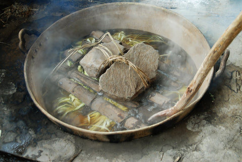 Boiling the plant leaves.