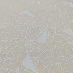 White triangles on cream background