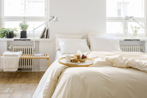 Bedroom setting with beige organic cotton covers from Knotte
