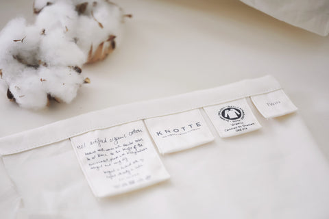 Knotte Logo and tags on all bedding products with cotton ball
