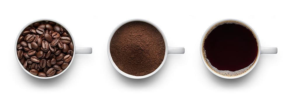 coffee cups with beans, grounds, and liguid