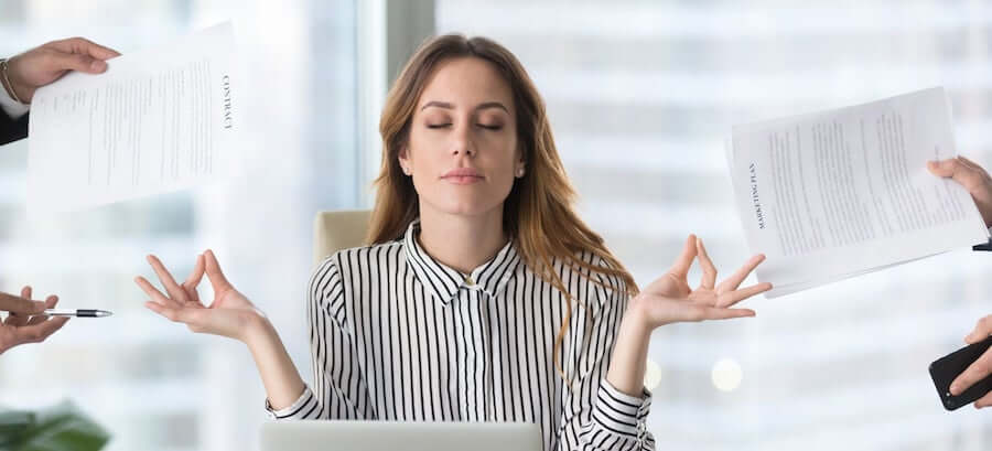 woman remaining calm in busy office