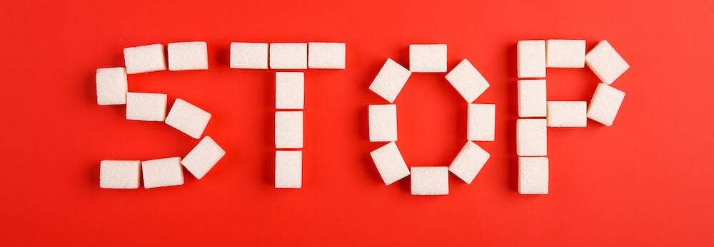 the word stop spelled out in sugar cubes on red background